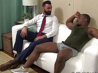 Black gay jacks off while bearded businessman licks his toes