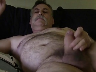Plump, hairy daddy jerks his rod while he's fucked