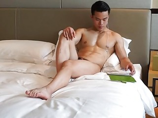 Chinese stud watches some porn then showers up