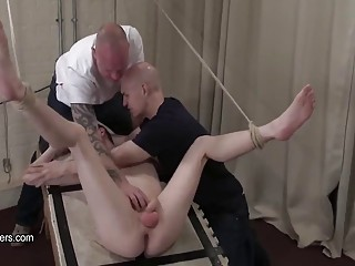 Tied boy can't avoid the dildo on a stick