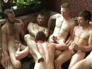 Unlucky dude gets flogged and fucked during BDSM orgy