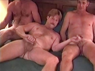 Three horny older guys meet up at a hotel for a threesome