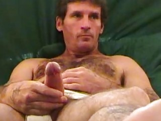Hairy ex-con plays with his dong in exchange for a few bucks