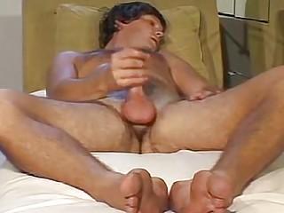 Hunk jacks off in a vintage gay porn vid