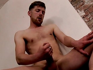 Jock strips nude and pulls his cock out to masturbate