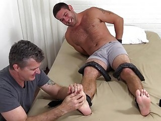 Hairy stud with a foot fetish restrained for kinky tickling