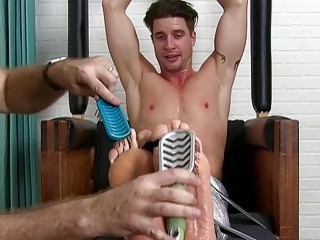 Stud restrained to have his body and bare feet tickled
