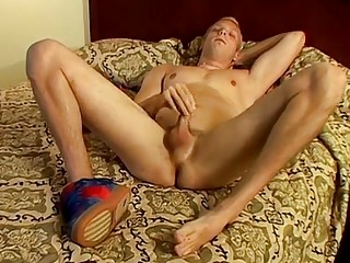 Blonde twink takes his clothes off to pee and masturbate