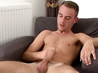 Attractive twink takes his dick out to stroke it solo