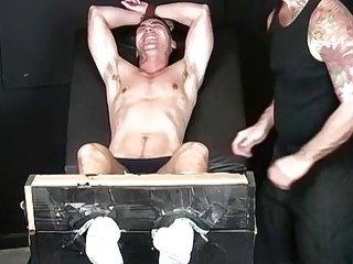 Muscular jock tied up for gay domination and erotic tickling