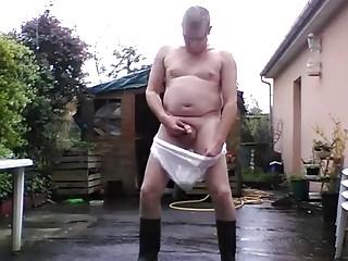 Older gay guy wears underwear and panties while masturbating