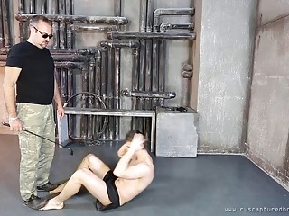 Chained thief has his back whipped during domination session