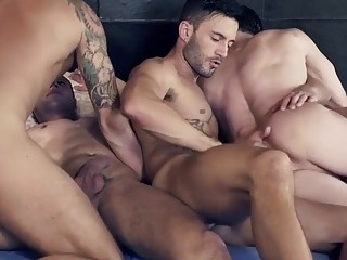 Horny gays pile into a bed for delicious group sex