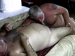 Furry daddy uses his tongue on his man's ass and dick