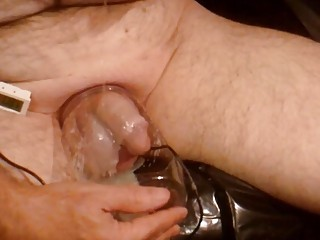 Fetish freak covers his cock and balls in wax