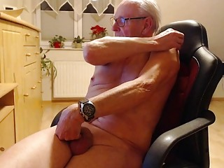 Elderly guy works his snake while chatting online