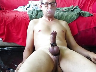 BDSM man's bound dick is turning purple