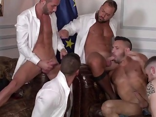 Group sex of gay men pounding away at each other