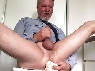 Older daddy rides a dildo while beating his meat