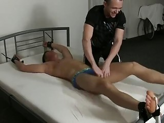 Poor Dorian is strapped down for intense tickle torture