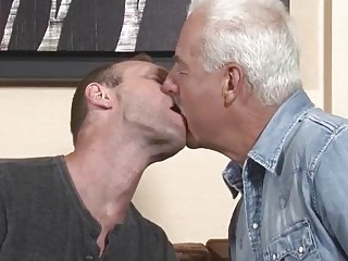 White-haired daddy diddles his young stud