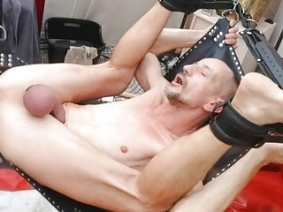 Older gay sets up a sling to ride a dildo