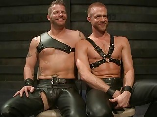 BDSM leather daddies act out a scene