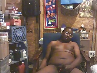 Plump black guy wanking his rod