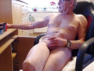 Aging homo chatting with others while nude