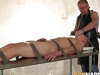 Submissive twink restrained and sucked off by older master